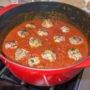 meatballs in sauce in red pot