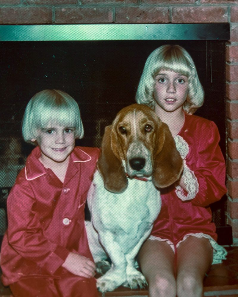 two kids and a basset hound in red pajamas