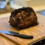 Ten Pound Prime Rib cooked and resting on cutting board with knife