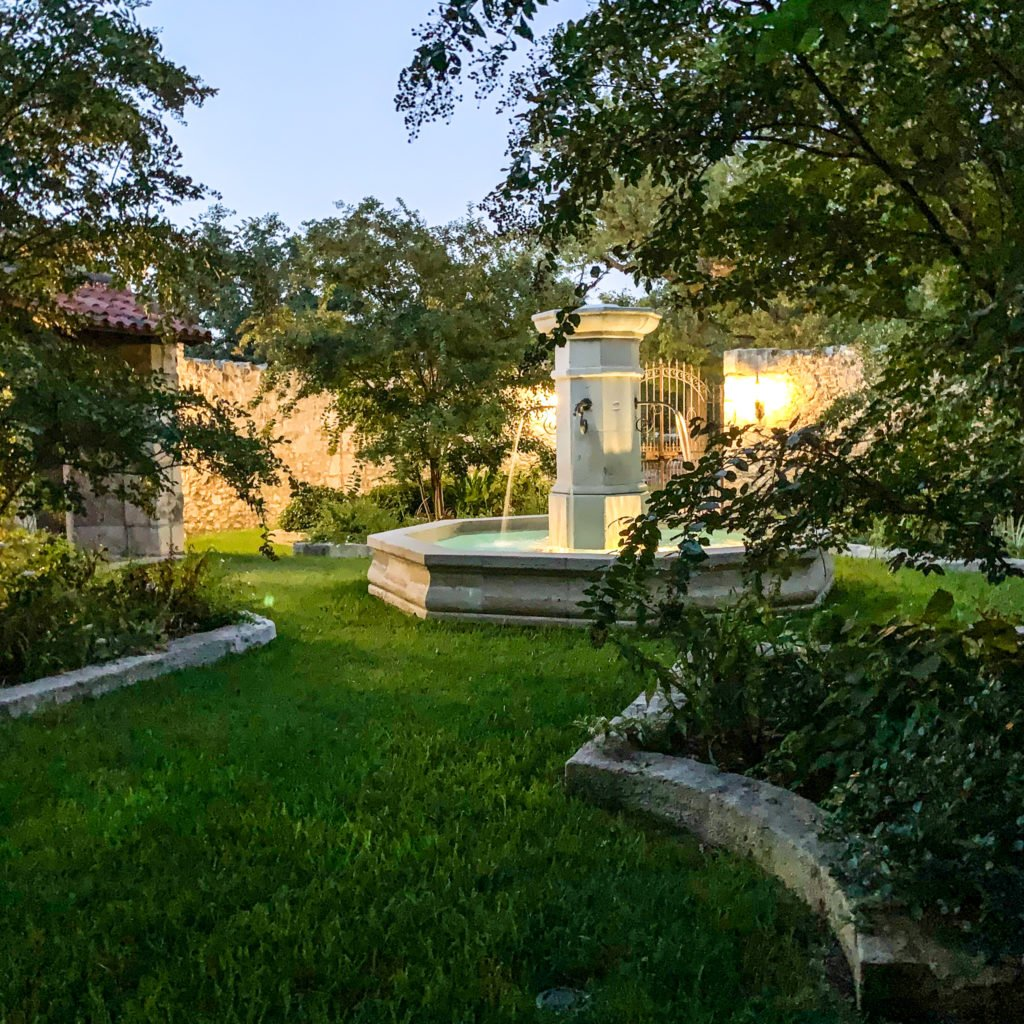 courtyard with fountain at dusk - J Dub By Design