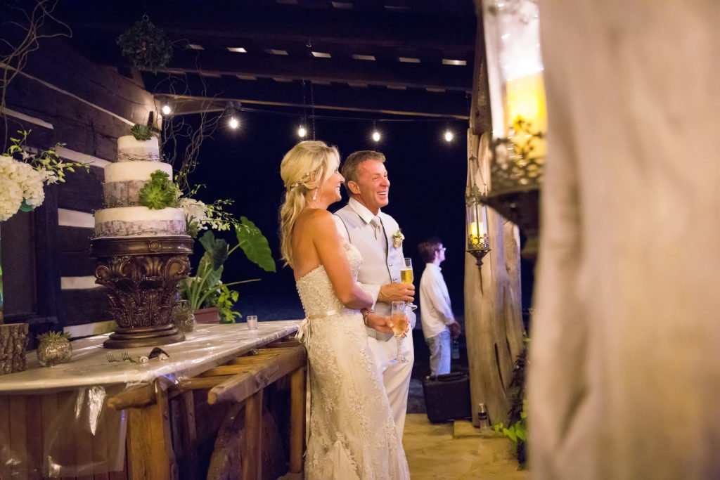Jennifer and David Williams in front of wedding cake - J Dub By Design