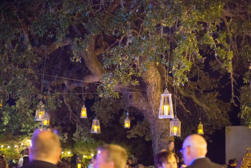 lanterns hangin from oak tree at wedding reception - J Dub By Design