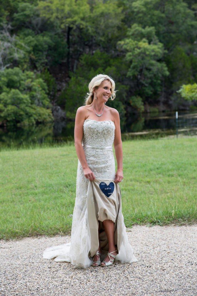 Jennifer Williams holding wedding train up to show something blue - J Dub By Design