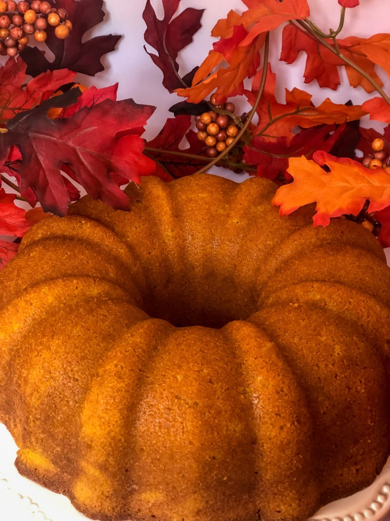 pumpkin pound cake surrounded by fall leaves - J Dub By Design
