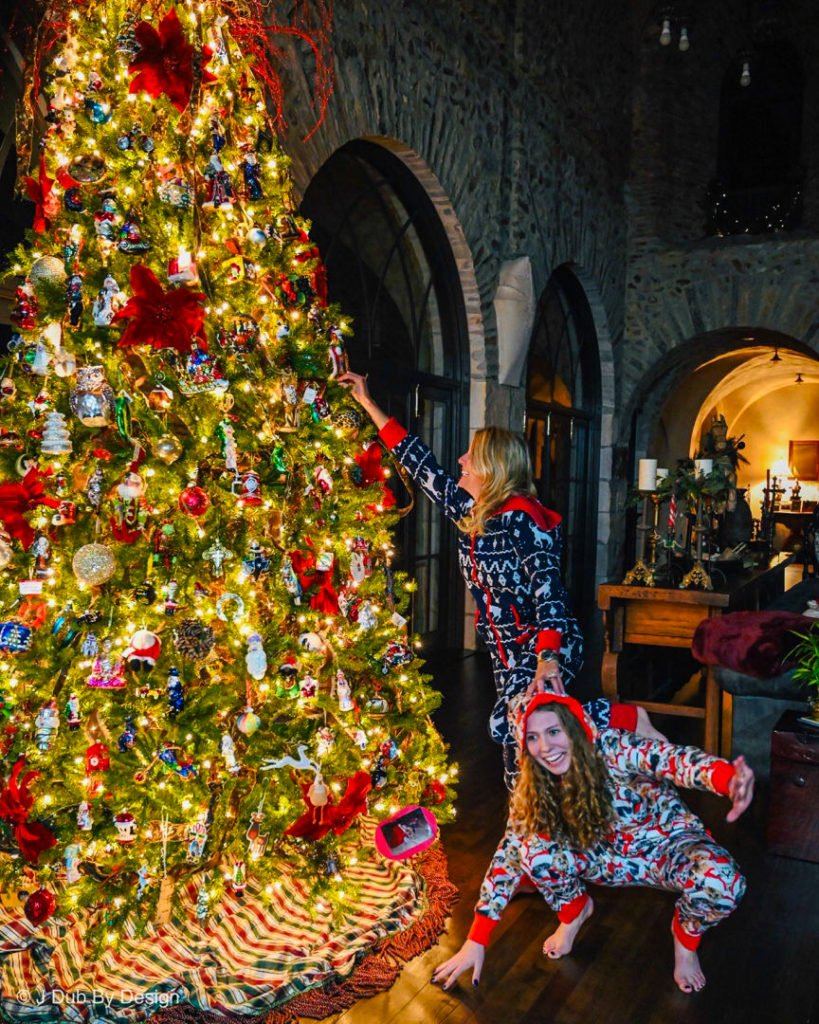 Jennifer and Eve in front of Christmas tree wearing pajamas - J Dub By Design