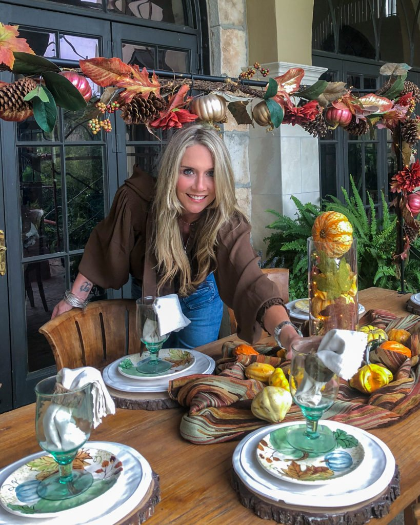 woman setting a fall tablescape - J Dub By Design