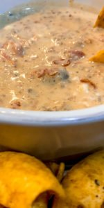 closeup of sausage queso in a bowl - J Dub By Design