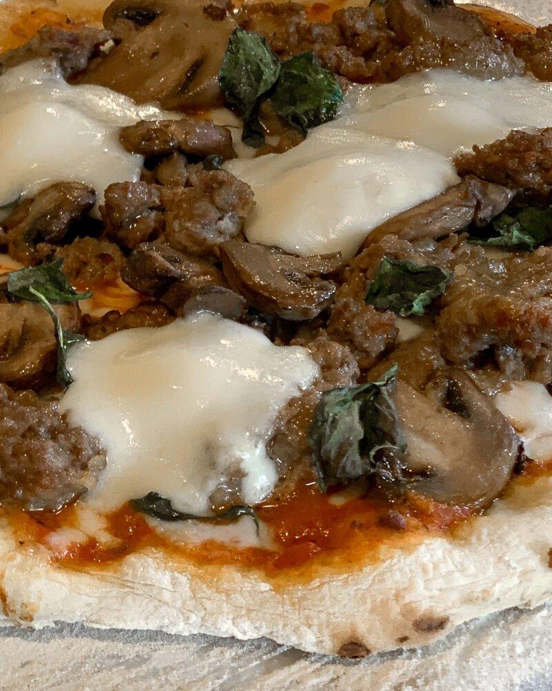 Italian sausage, mushroom and basil pizza