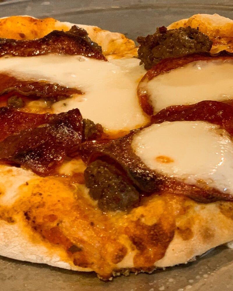 pepperoni and italian sausage with mozzarella pizza