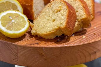 lemon pound cake sliced on cake stand - J Dub By Design