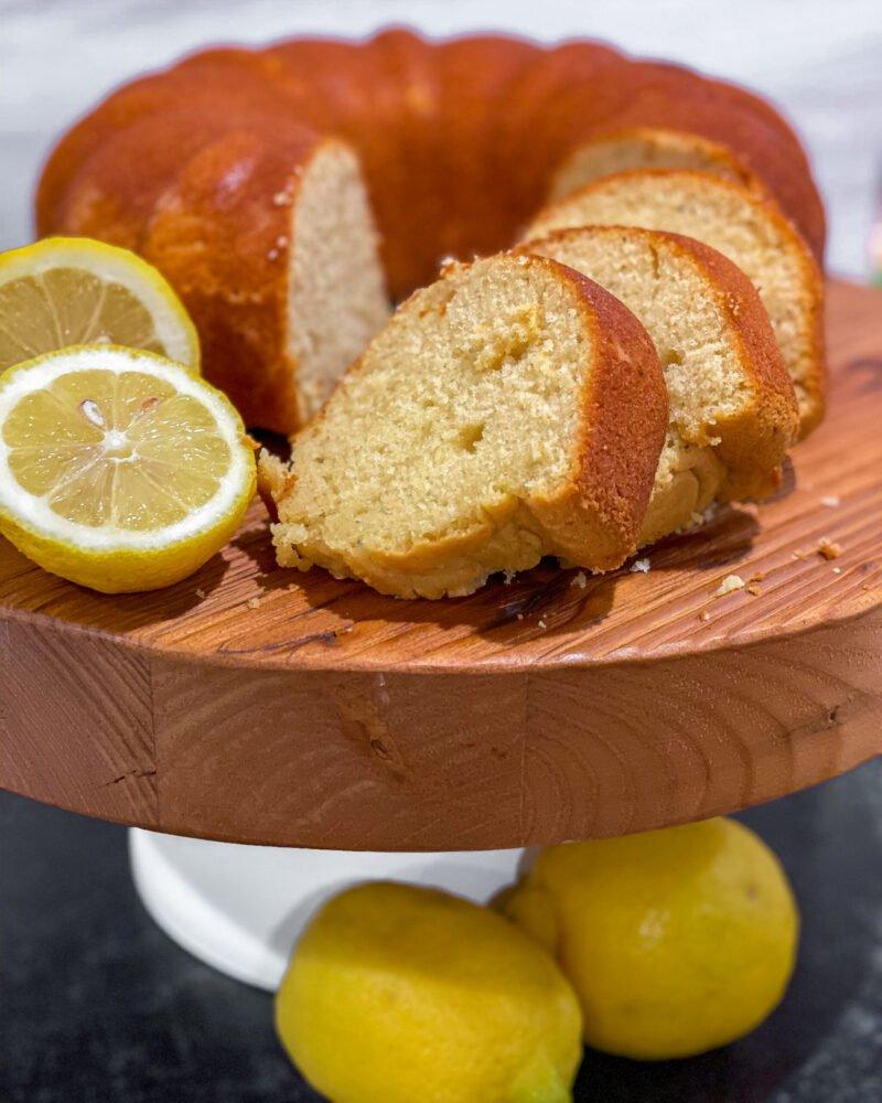 lemon pound cake sliced on cake stand - J Dub By Design
