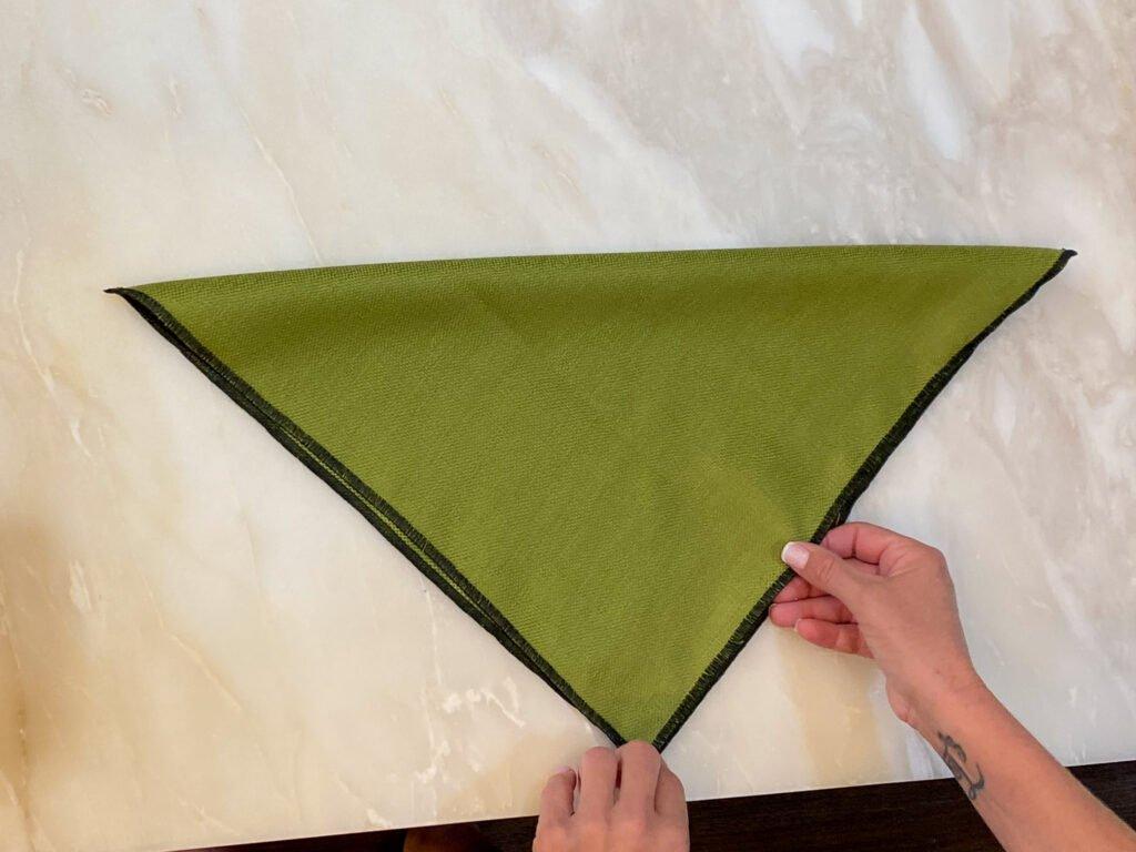green napkin folded in half - J Dub By Design