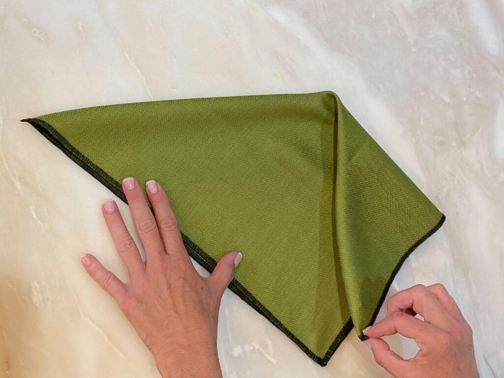 folding green napkins - J Dub By Design
