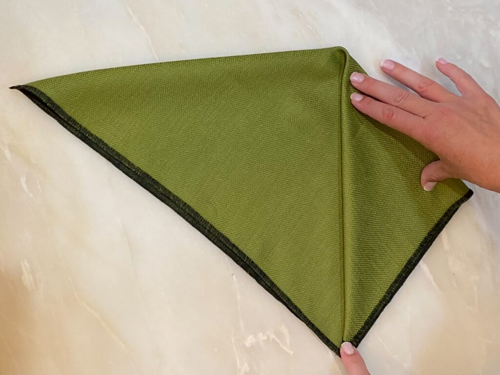 folding green napkin - J Dub By Design