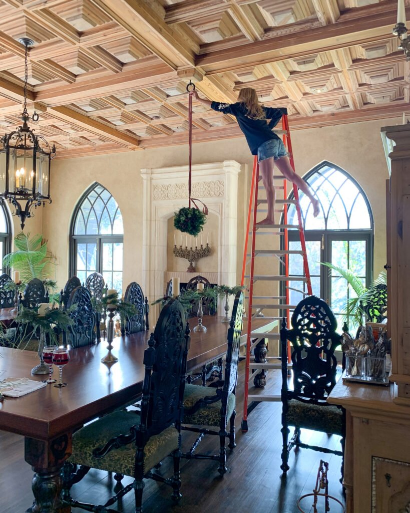 Jennifer Williams standing on ladder in dining room - J Dub By Design