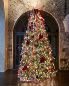 12 foot Christmas tree decorated with mercury glass ornaments and poinsettias - J Dub By Design