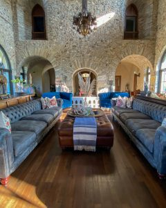Living room with stone walls - J Dub By Design
