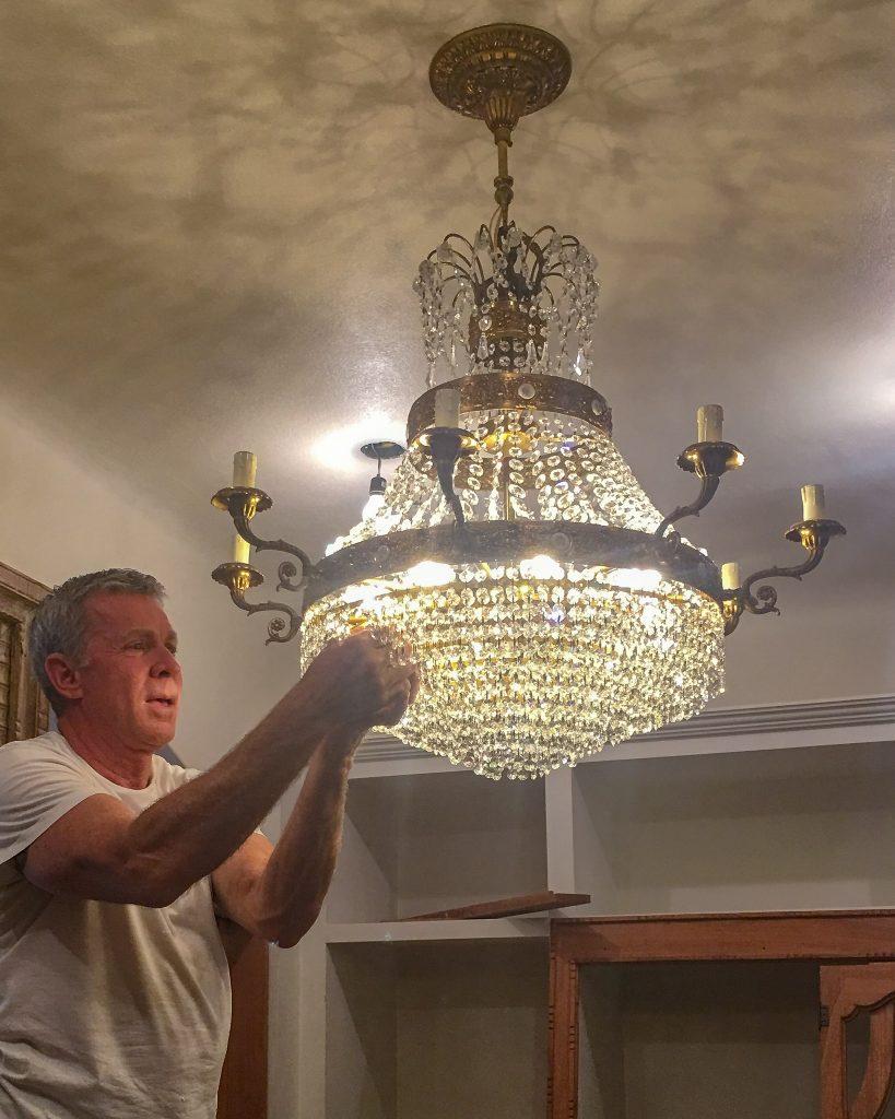 vintage chandelier hanging in master closet - J Dub By Design