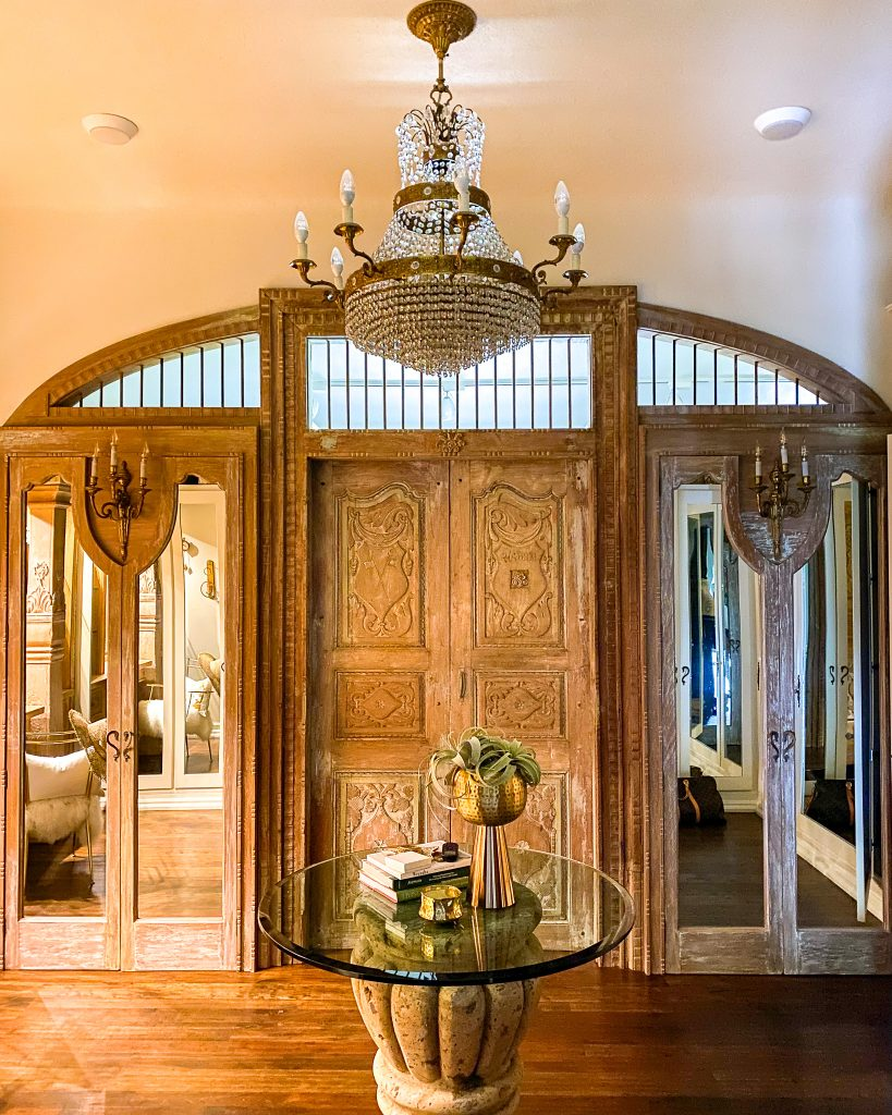 Women's Master Closet with vintage chandelier and antique door - J Dub By Design