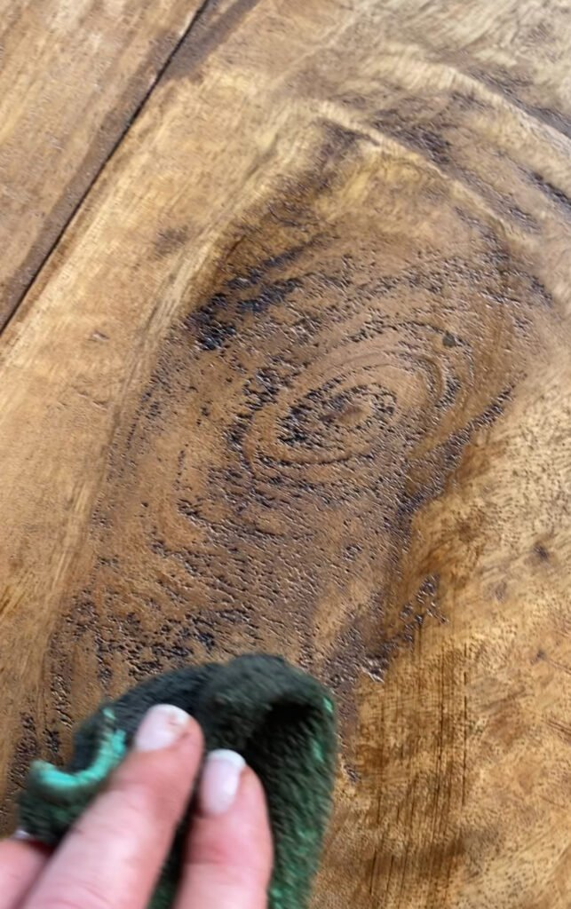 rubbing dark wax into the distressed areas of top of table - J Dub By Design