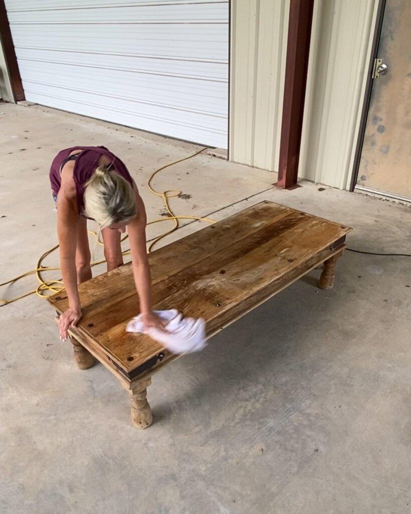 wiping the dust off coffee table after sanding - J Dub By Design
