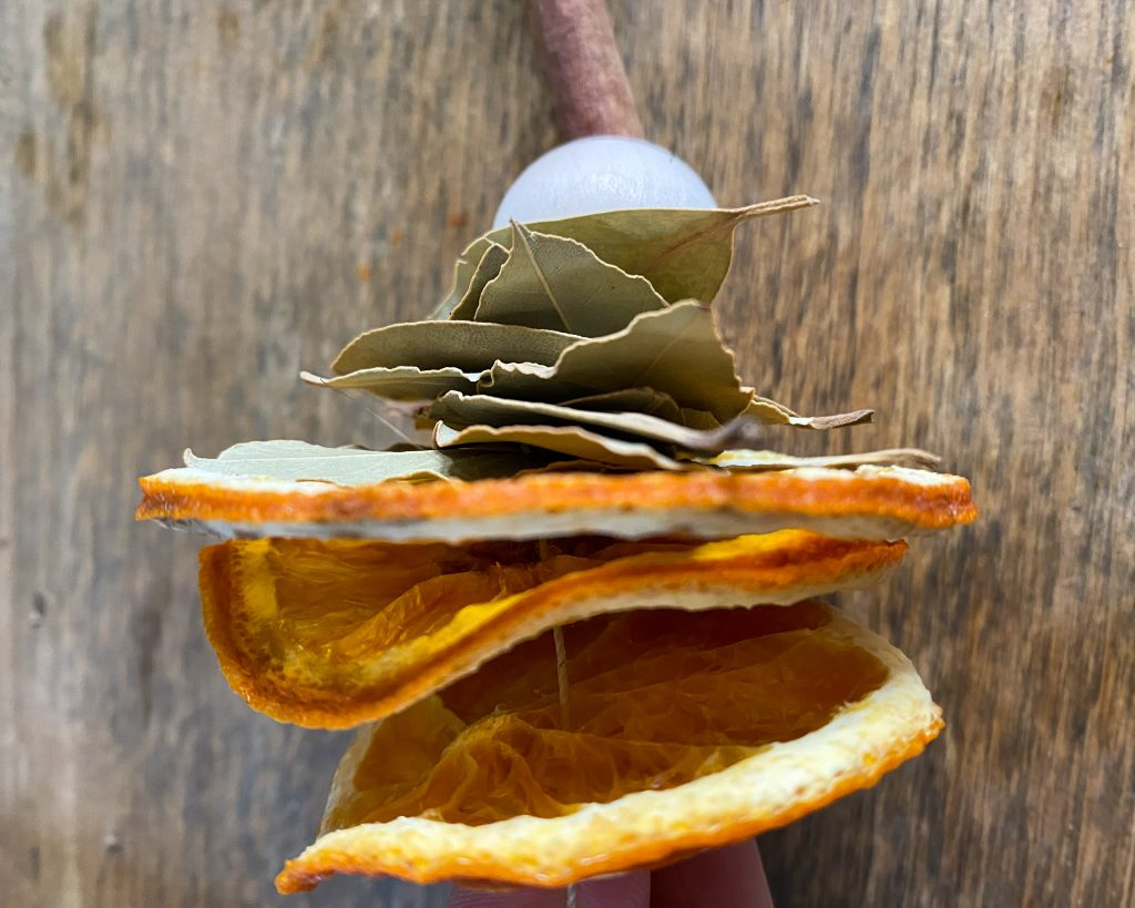 stacked dried orange slices, bay leaves and bead - J Dub By Design