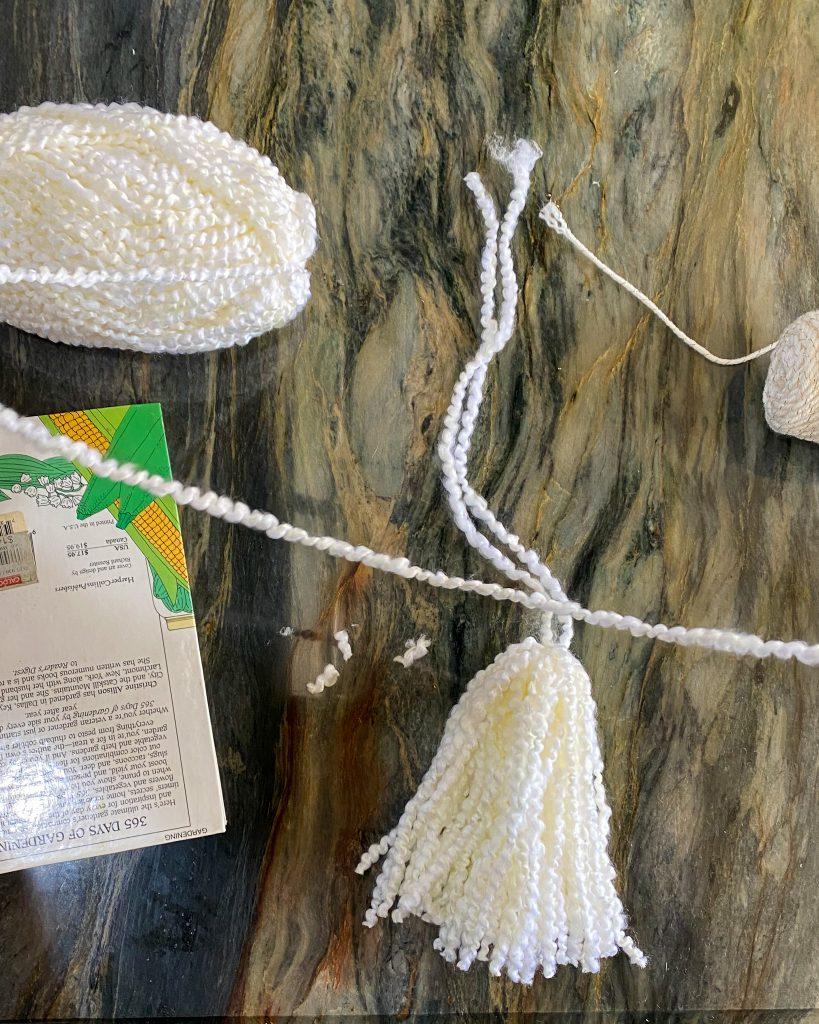 cutting yarn piece for top of tassel - J Dub By Design