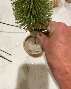 putting brush tree in pot of clay - J Dub By Design