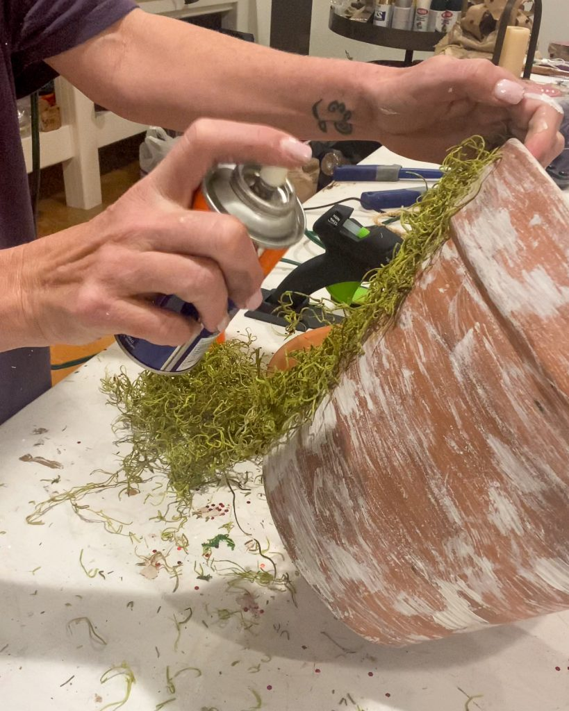 using spray adhesive to attach moss to pot - J Dub By Design™