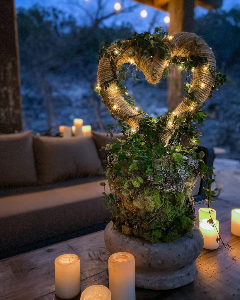 Valentines Day DIY Fig Vine Topiary on outdoor patio surrounded by candles - J Dub By Design™