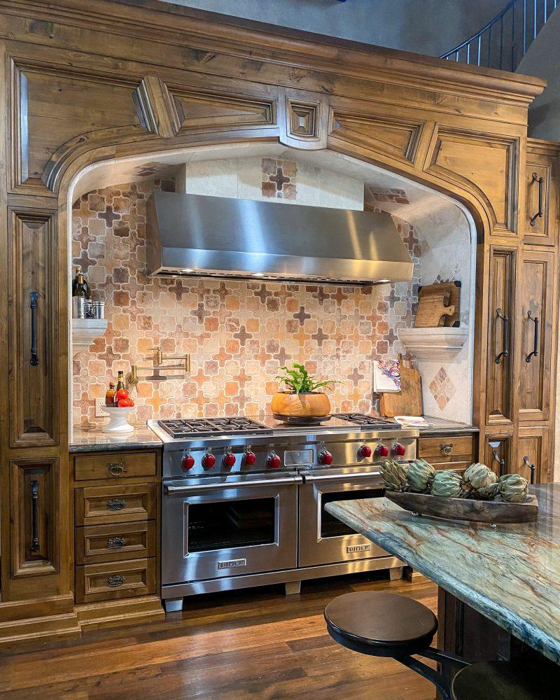 kitchen range with knotty alder cabinets and tile backsplash - J Dub By Design™