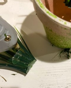 gluing faux grass to the inside of small terra cotta pot - j Dub By Design™
