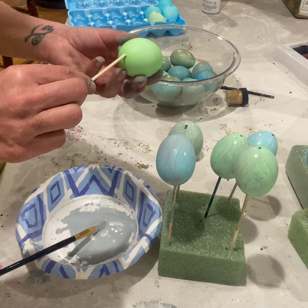 using a skewer to paint eggs - J Dub By Design™