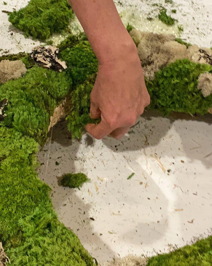 gluing moss to the inside of the straw wreath form - J Dub By Design™