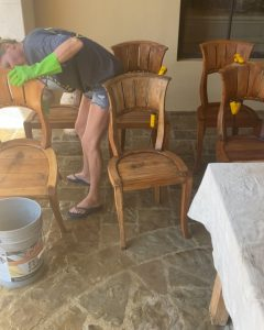 woman cleaning wood chairs in preparation for staining - J Dub By Design™