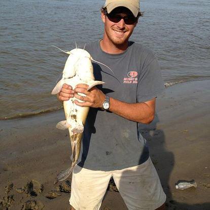 Clayton holding a fish - J Dub By Design™