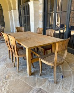 old wood table with six chairs on patio - J Dub By Design™
