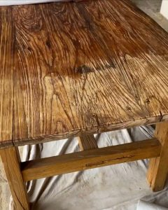 dry and wet areas of the table after applying Citristrip in stages - J Dub. By Design™