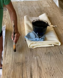 dry brushing custom stain and topcoat on the elmwood table top - J Dub By Design™