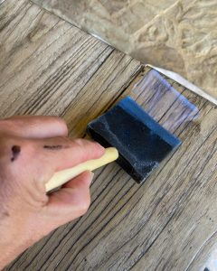 using a 3 inch foam brush to apply clear topcoat to table - J Dub By Design™