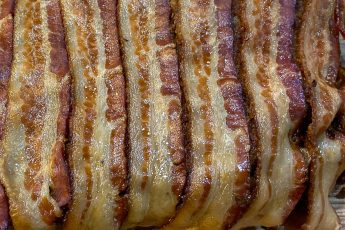 brisket covered in bacon and cooked in the oven - J Dub By Design™
