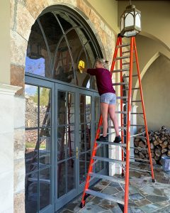 Jennifer Williams on 12 foot ladder cleaning windows on her patio - J Dub By Design™