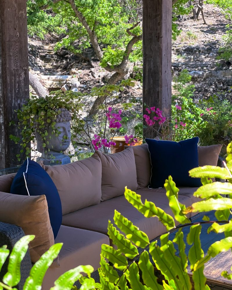 Clean patio cushions on an outdoor patio with ferns and flowers - J Dub By Design™