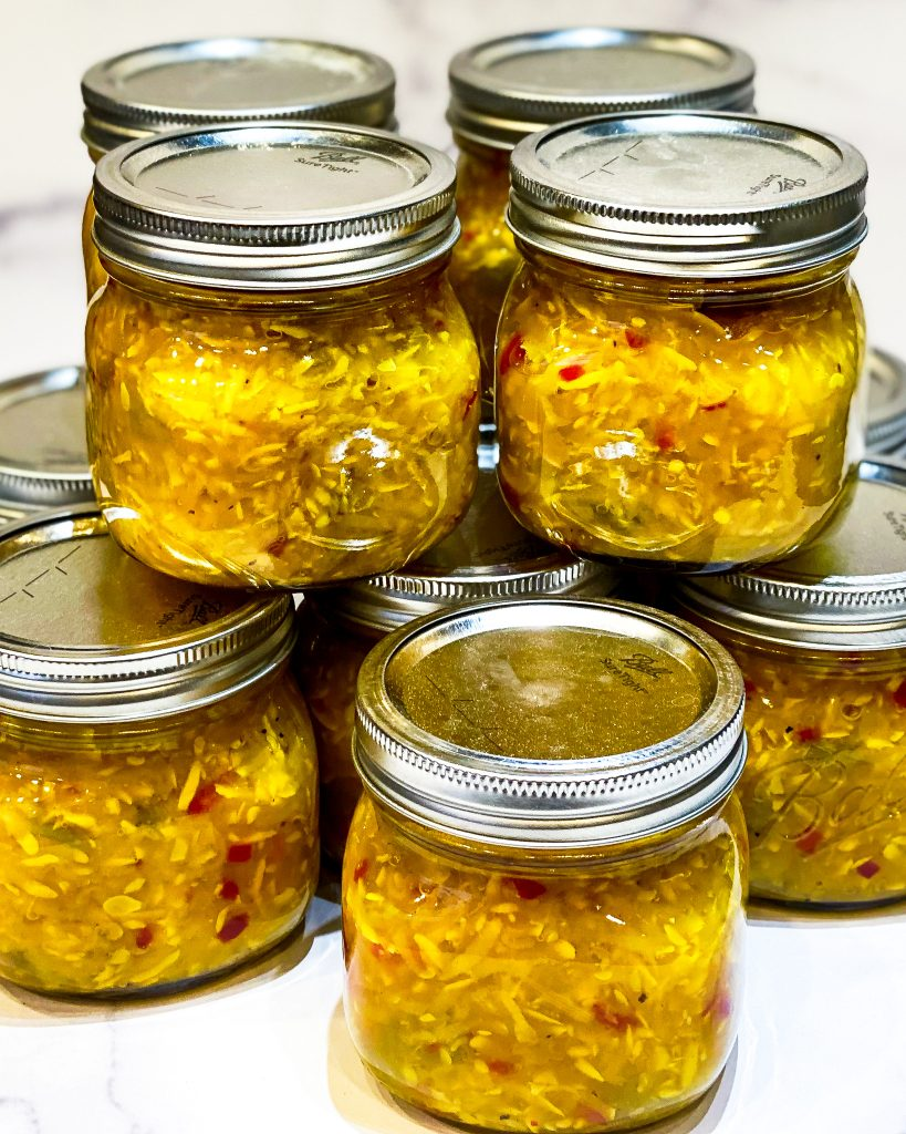 J Dub's squash relish stacked in small canning jars - J Dub By Design™