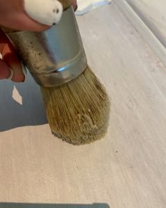 applying clear wax to the nightstand using a wax brush - J Dub By Design™
