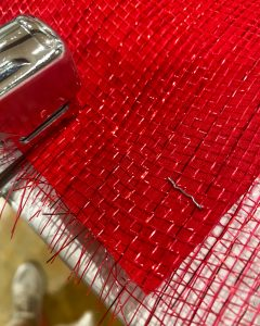 stapling red deco mesh and red fabric together - J Dub By Design™
