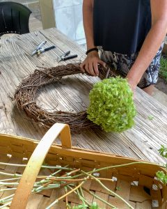 placing a large hydrangea bloom in grapevine wreath form - J Dub By Design™
