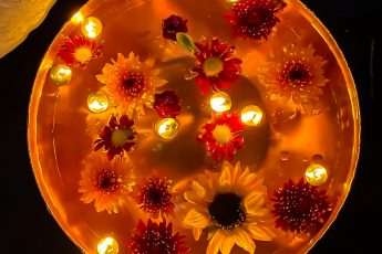 overhead view of floating candle flower centerpiece - J Dub By Design™