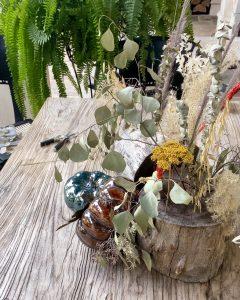 pumpkins nestled into the sides of the dired floral arrangement - J Dub By Design™